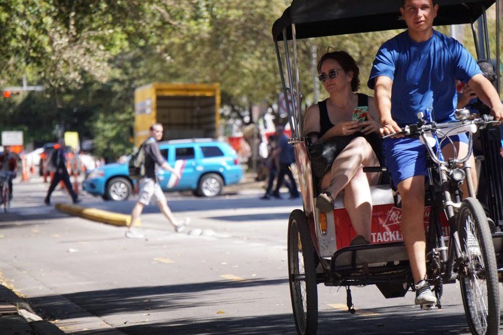 SXSW Woman riding in jinrikisha